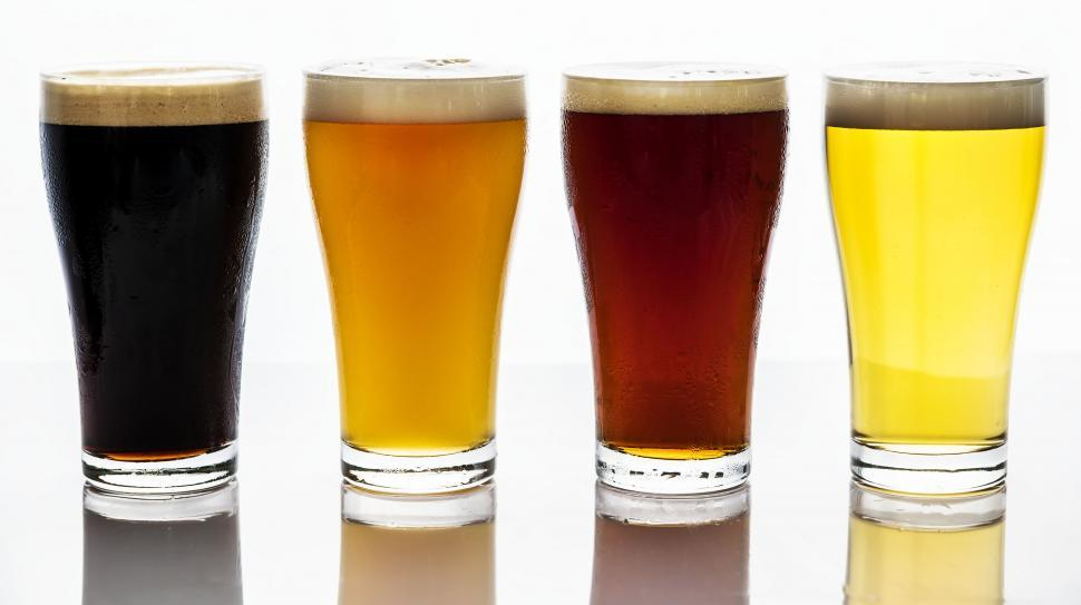 Download Free Stock HD Photo of Close up of four beers served in pint glasses Online