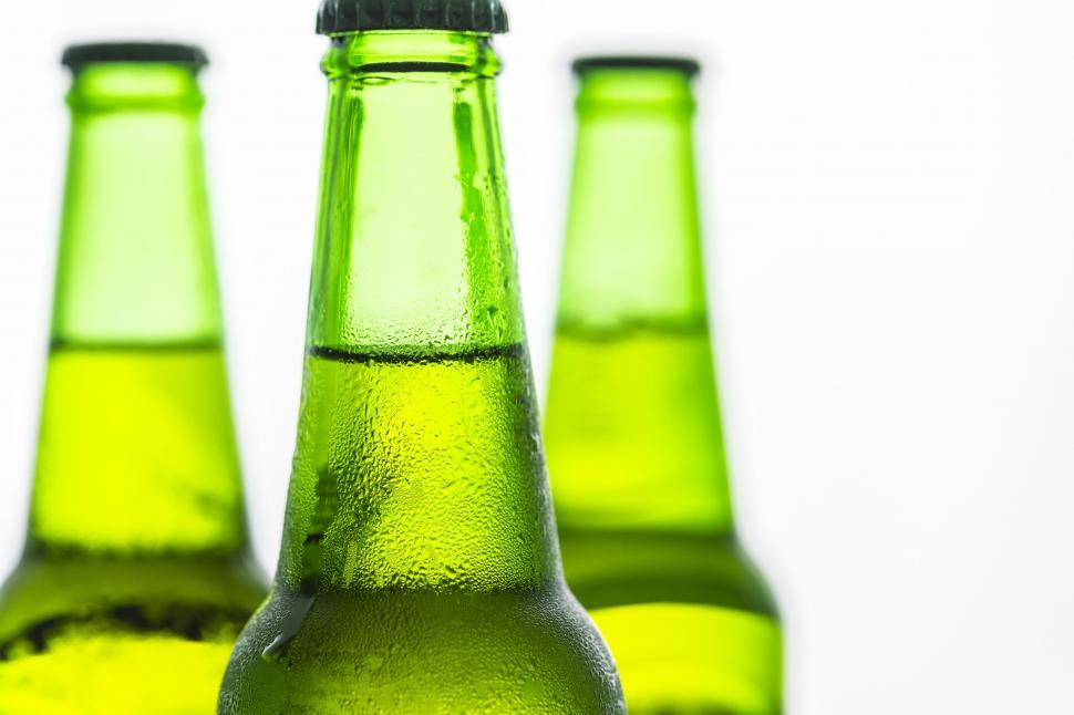 Download Free Stock Photo of Three beer bottles of green glass