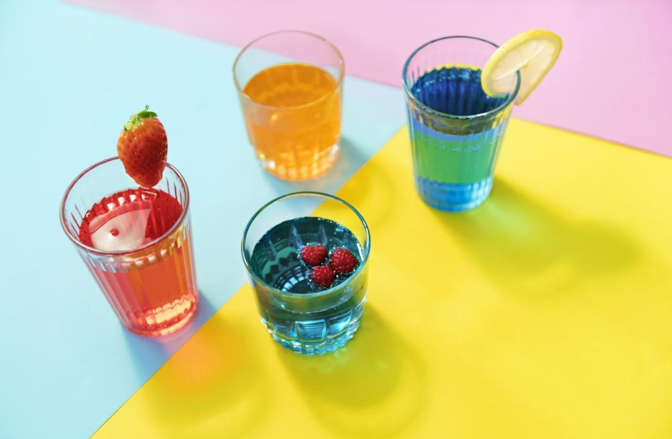 Download Free Stock Photo of Close up of colorful beverages in four glasses