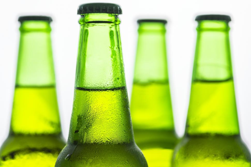 Download Free Stock Photo of Close up of beer bottle necks - green glass