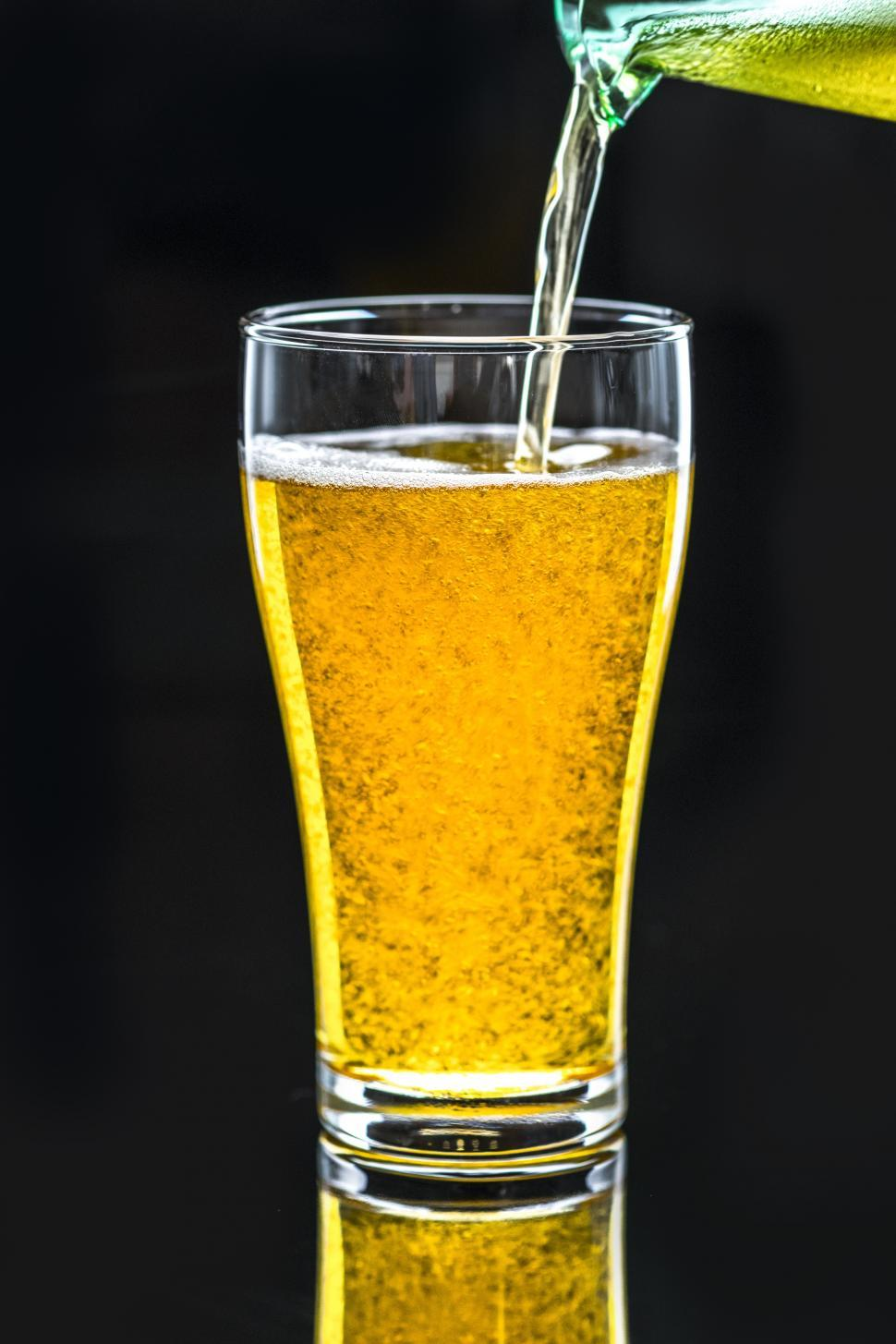 Download Free Stock Photo of Pale beer being poured into a pint glass