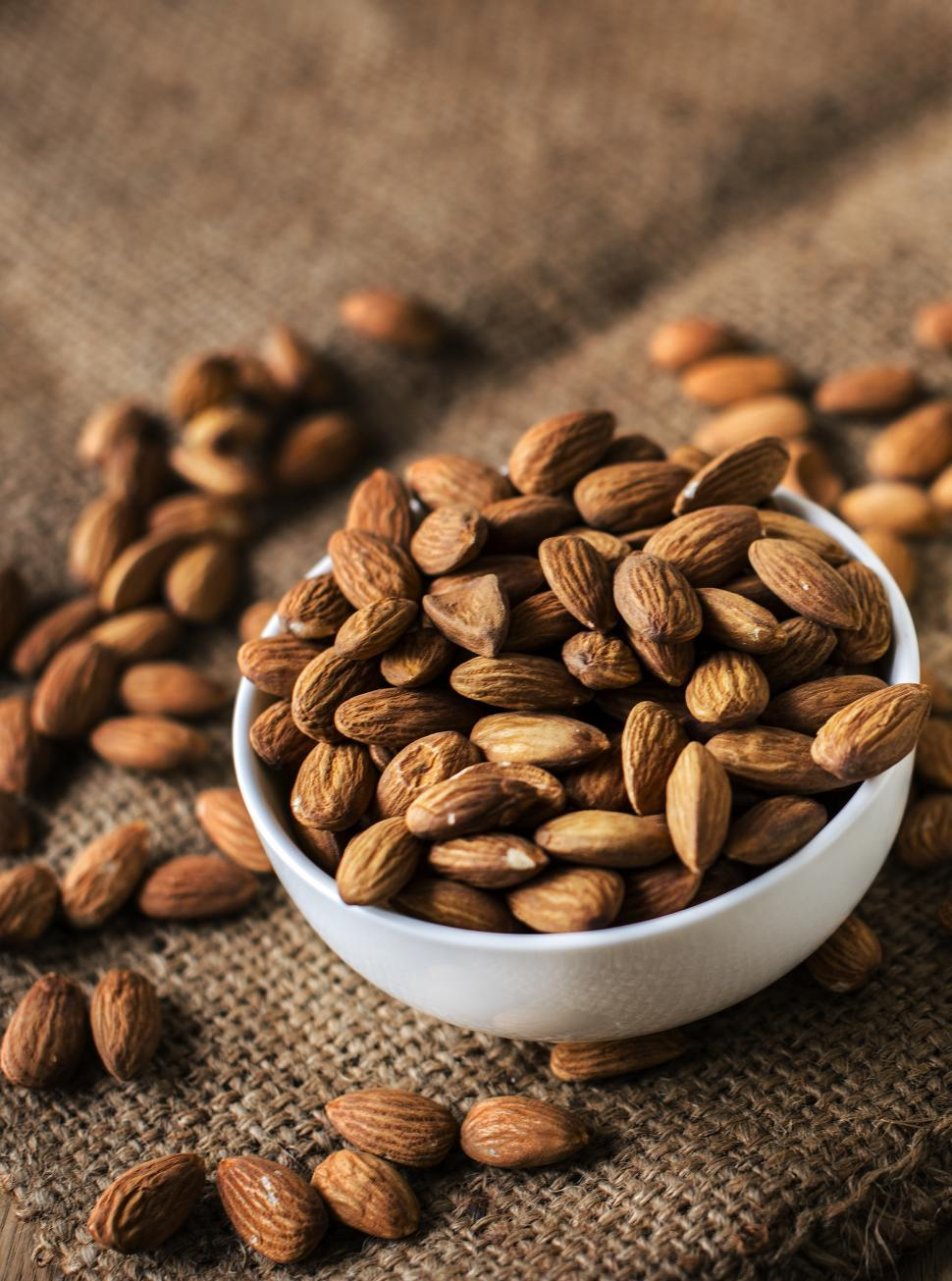 Download Free Stock HD Photo of Close up of a bowl full of almonds Online