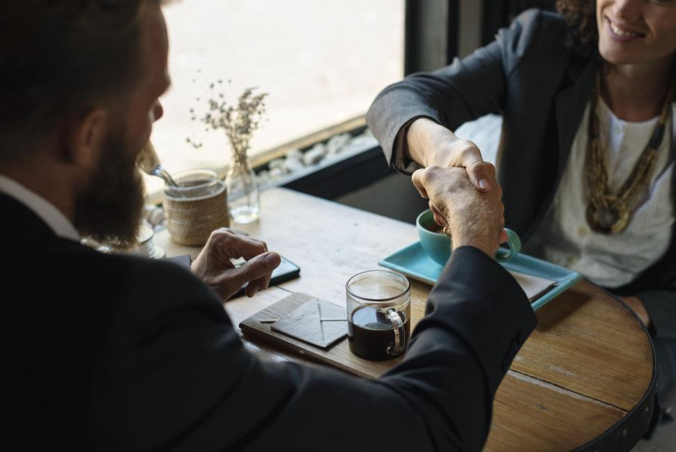 Download Free Stock HD Photo of Handshake between two business people over a drink Online