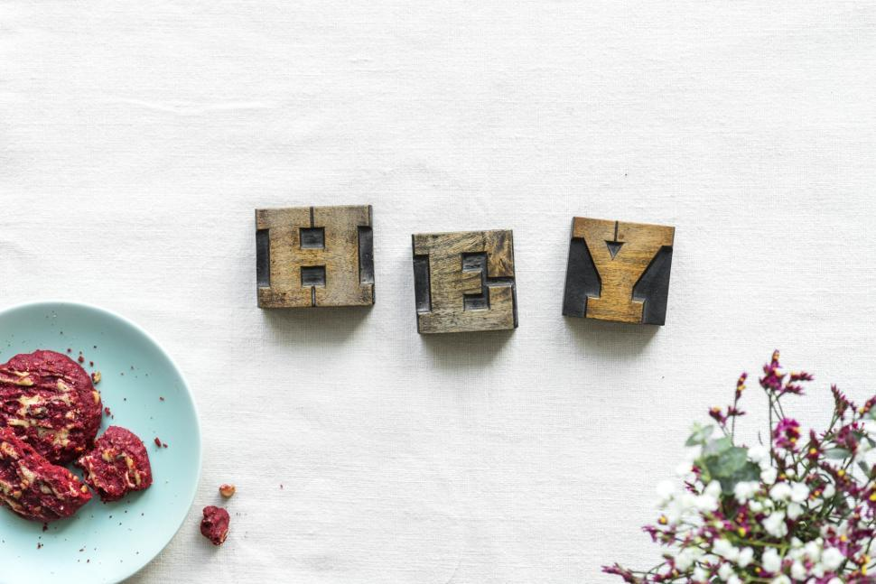 Download Free Stock Photo of Overhead view of the word HEY written with wooden alphabet blocks