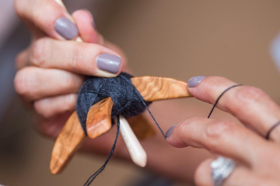 Download Free Stock HD Photo of Hands of woman spinning yarn Online