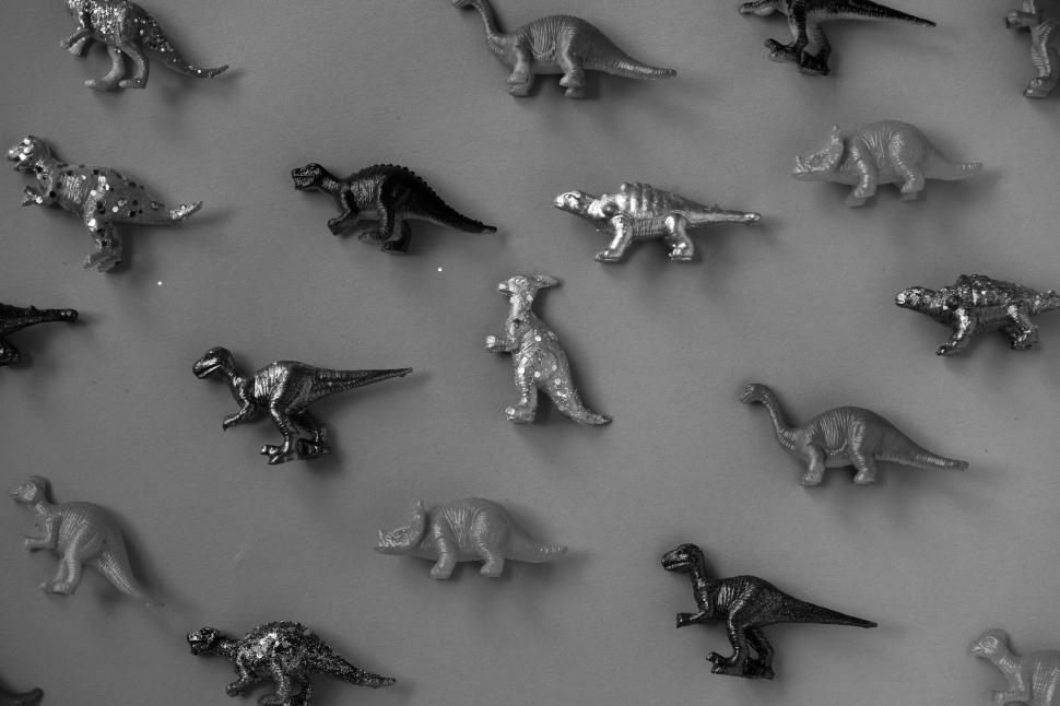 Download Free Stock HD Photo of Toy dinosaurs on flat surface Online