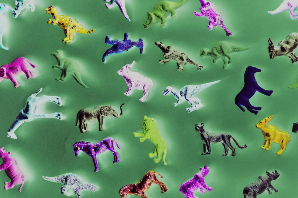 Download Free Stock Photo of Inverted processed color image of toy animals on green surface