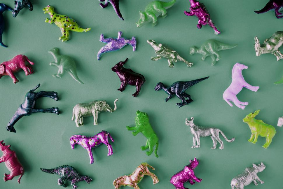 Download Free Stock HD Photo of Colorful toy animals on green surface Online