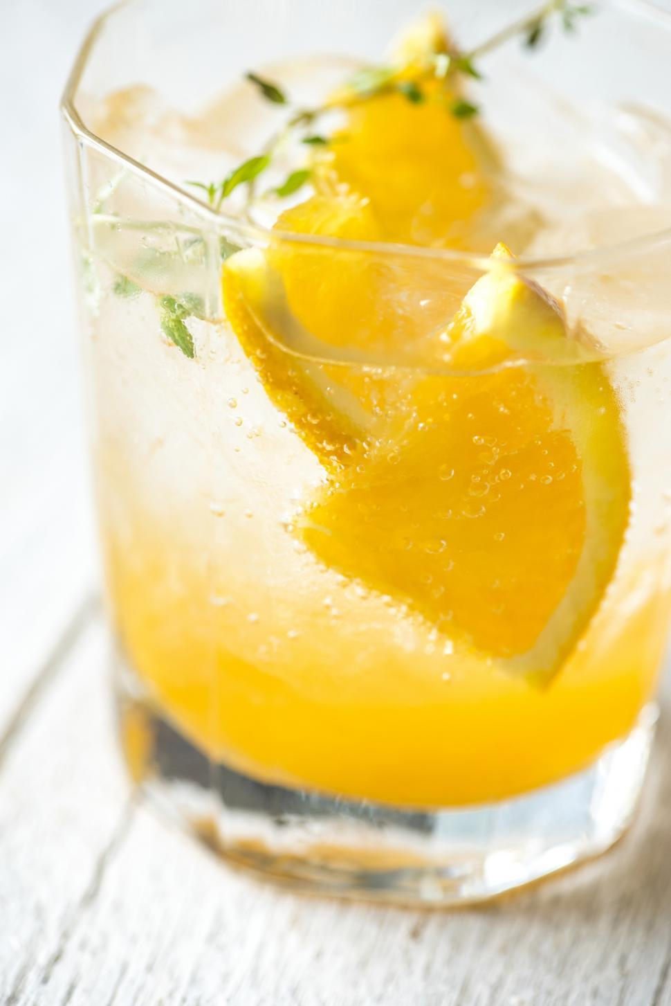 Download Free Stock Photo of Close up of fresh beverage in a glass garnished with orange slices