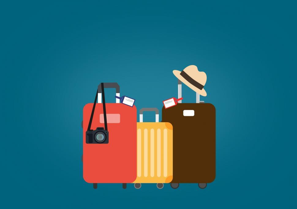 Download Free Stock Photo of Travel Suitcases with Hat and Camera- Travel and Tourism Concept