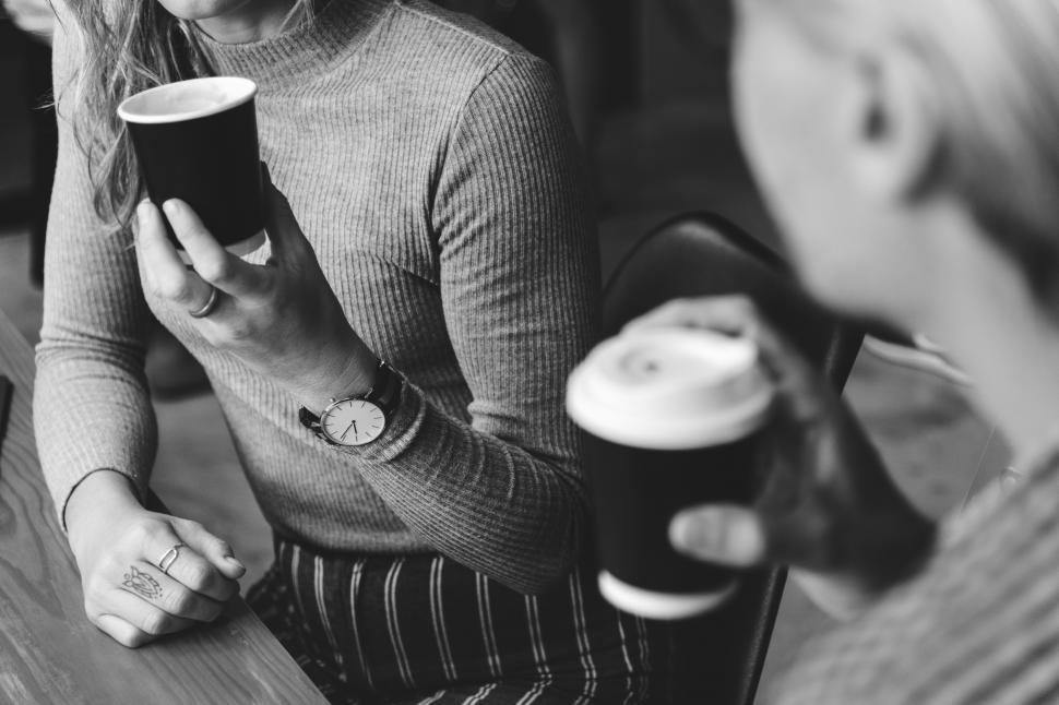 Download Free Stock Photo of A young woman hand holding a travel coffee cup