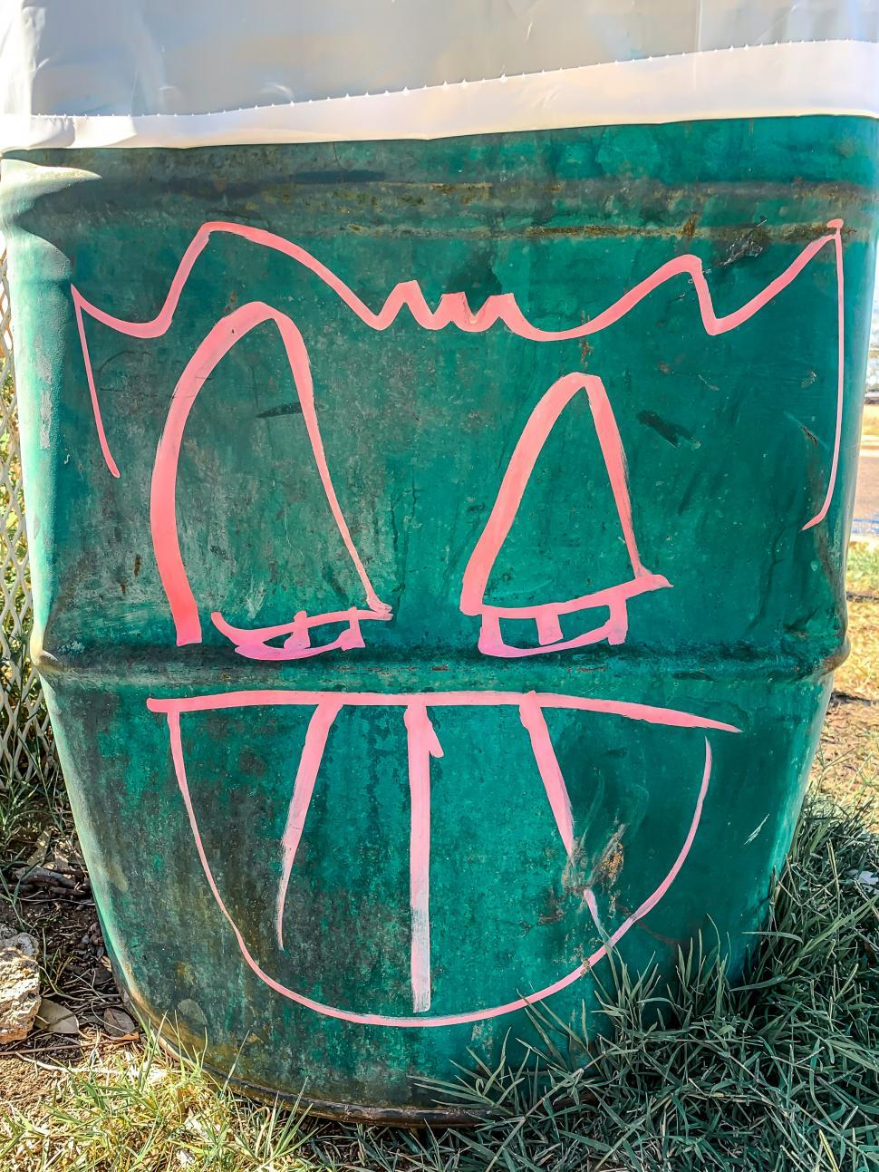 Download Free Stock HD Photo of Strange Smiliing Face on Garbage Can Online