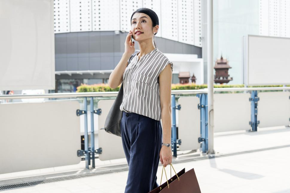 Download Free Stock HD Photo of An Asian woman calling on her mobile phone Online