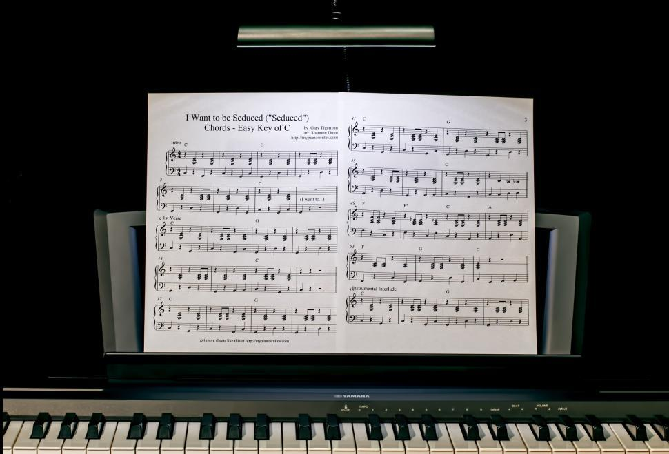 Download Free Stock Photo of piano lesson music keyboard piano pianist practice light darkness music stand music score sheet music dark scores