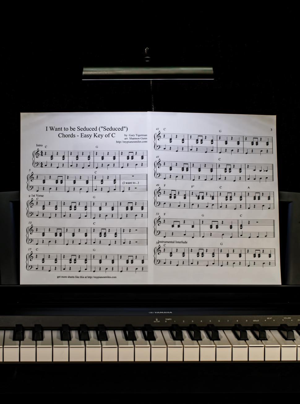Download Free Stock Photo of piano lesson music keyboard piano pianist practice light darkness music stand music score sheet music dark