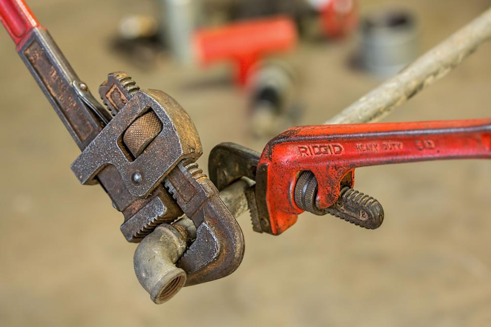 Download Free Stock Photo of plumbing pipe wrench repair maintenance fix tool connect handyman spanner tighten screw thread plumber workman home repair toolbox tight fasten monkey wrench