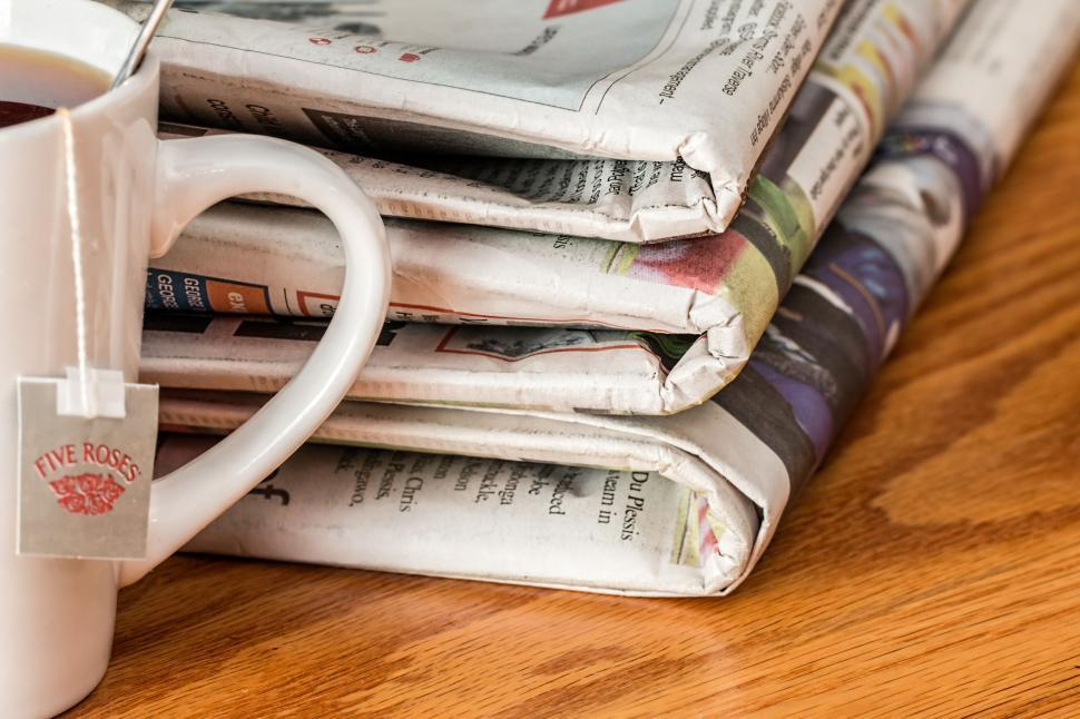 Download Free Stock Photo of Newspaper With Tea