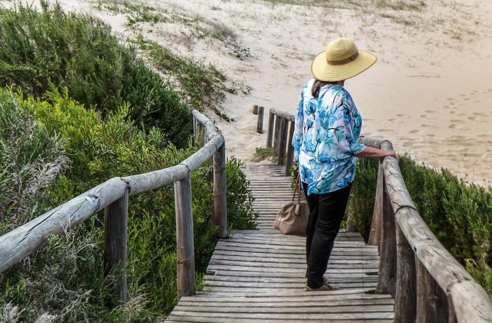 Download Free Stock Photo of woman, alone, lonely, walkway, beach, seaside, sadness, adult, person, female, loneliness, thinking, pondering, outdoor, solitude, standing, contemplation, leisure, thoughtful, pensive, ponder, serious, summer, casual, lady, elegant, chic, straw hat, sunny