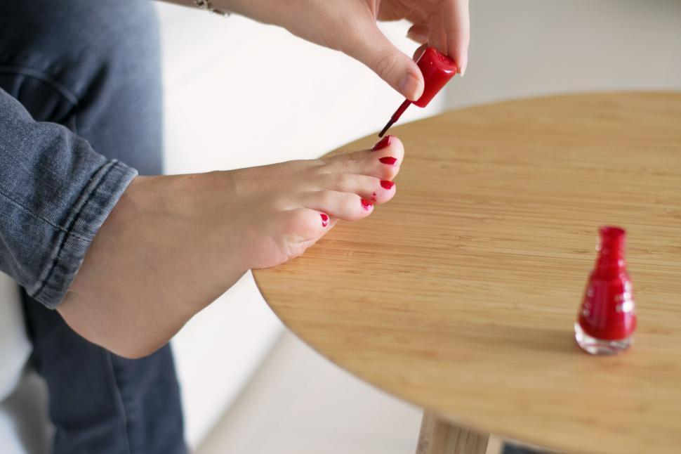 Download Free Stock Photo of Woman Toes and Red Nail Paint
