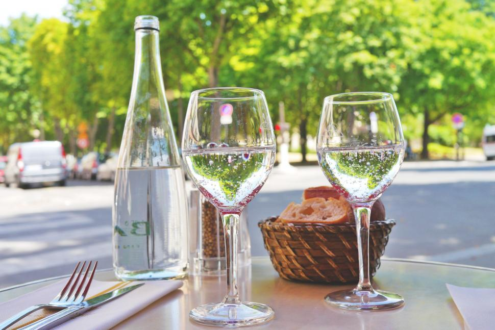 Download Free Stock Photo of Glasses of water with bread basket and cutlery