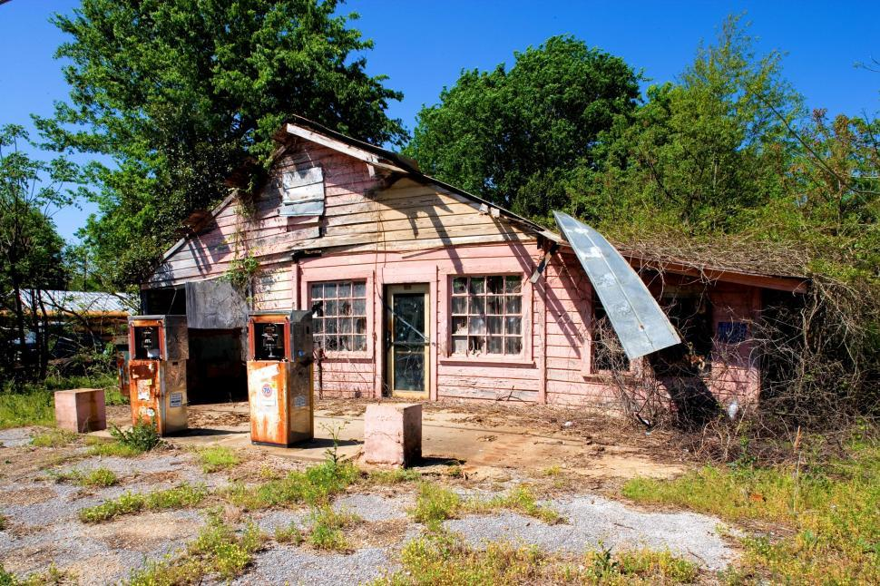 Download Free Stock Photo of Abandoned Petrol Station surrounded by trees