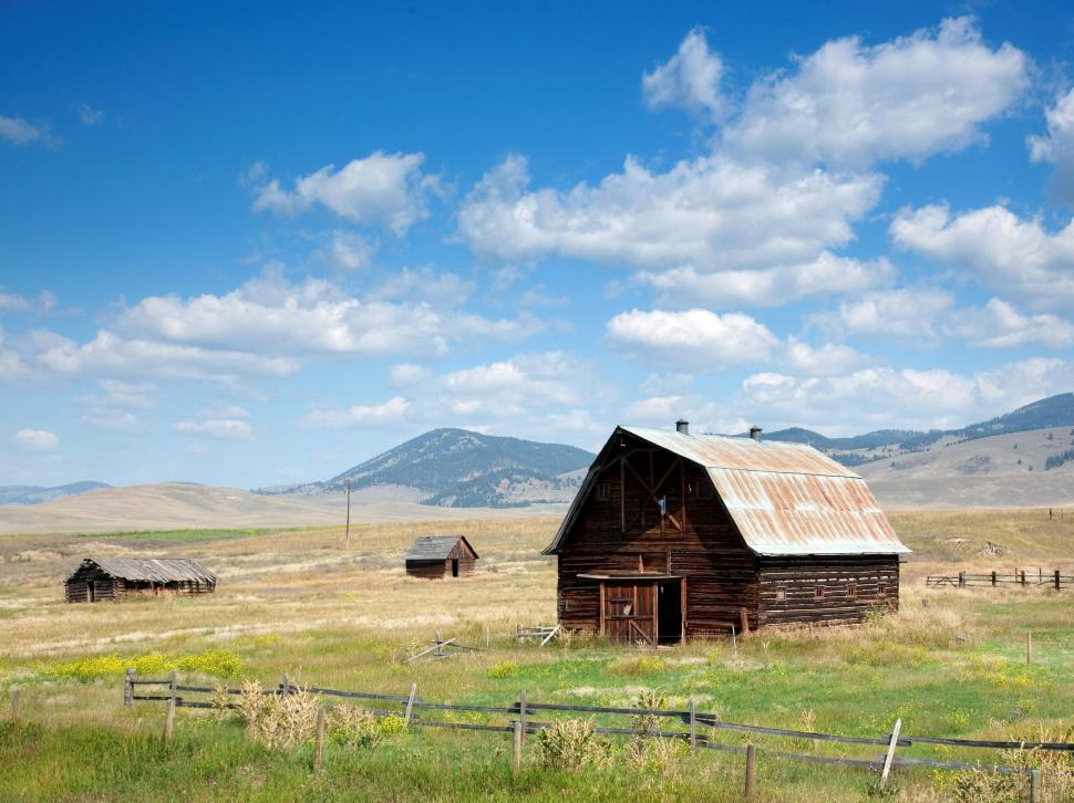 Download Free Stock Photo of Rolling Farm Land and Barns
