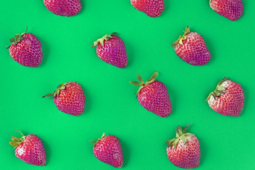 Download Free Stock HD Photo of Flay lay of strawberries on green surface Online