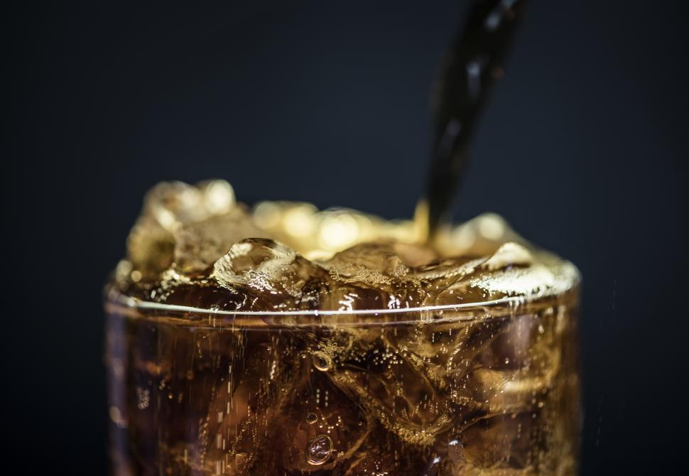 Download Free Stock HD Photo of Iced cola drink being poured into a pint glass Online