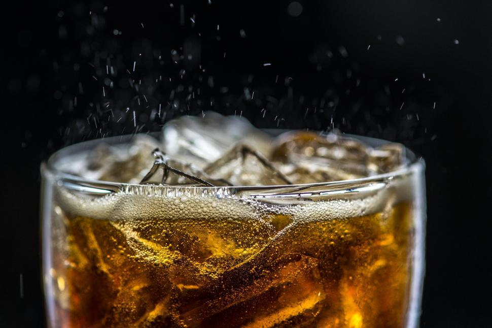 Download Free Stock HD Photo of Carbonated cola drink served in a pint glass Online