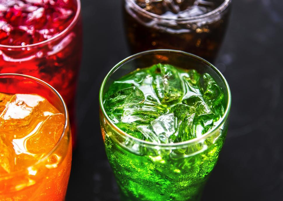 Download Free Stock HD Photo of Four colorful soft drinks in pint glasses Online
