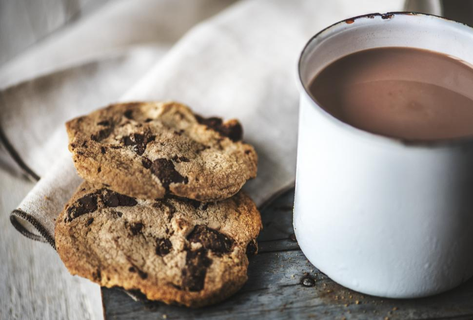 Download Free Stock Photo of Close up of chocolate chip cookies and hot chocolate in a mug