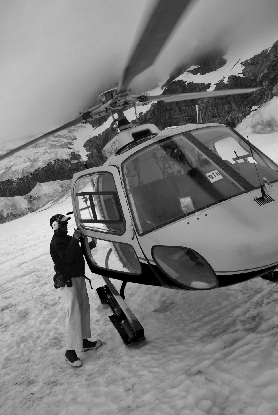 Download Free Stock Photo of Helicopter and Pilot in Snow