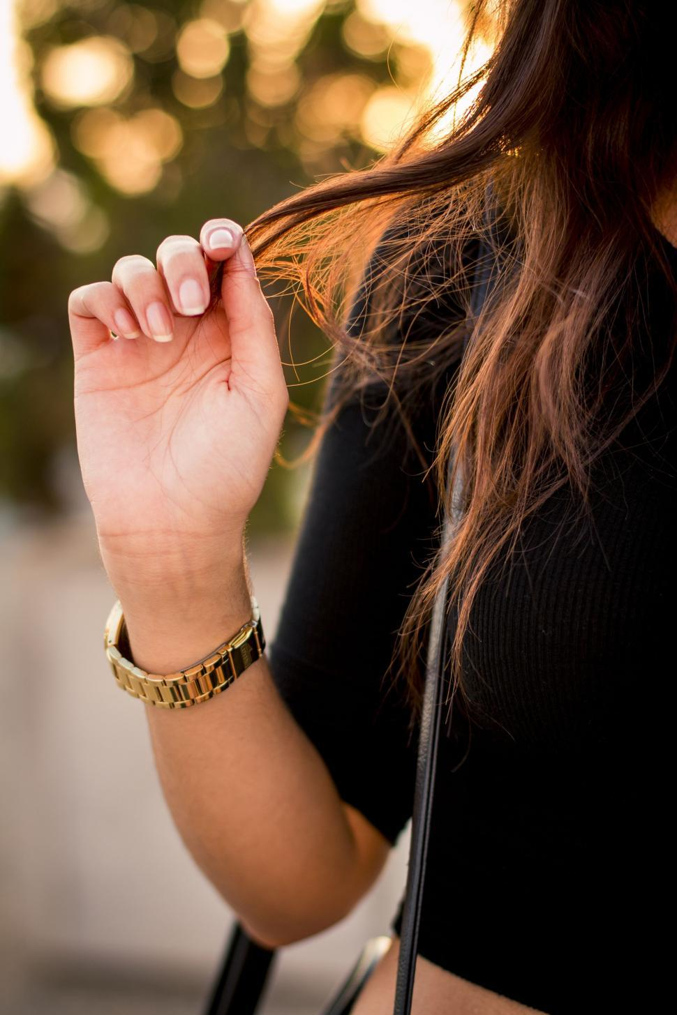 Download Free Stock Photo of Female hand with wrist watch