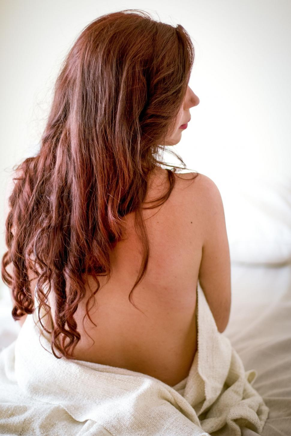 Download Free Stock Photo of Rear View of half naked woman on Bed