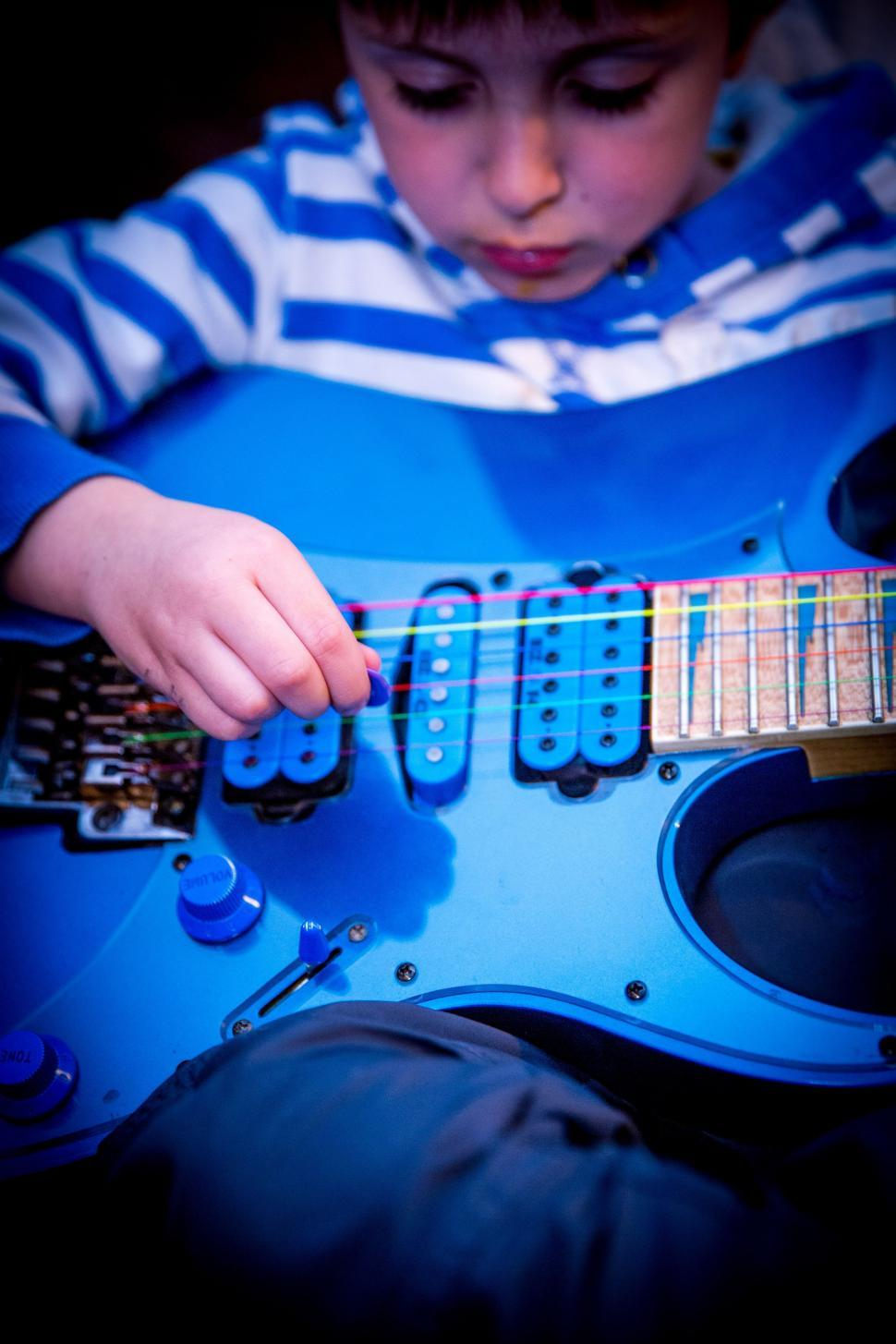 Download Free Stock HD Photo of Little boy with guitar Online