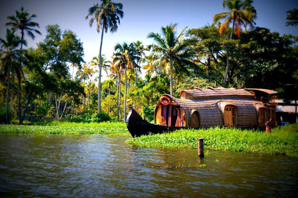 Download Free Stock Photo of Houseboat and Coconut trees