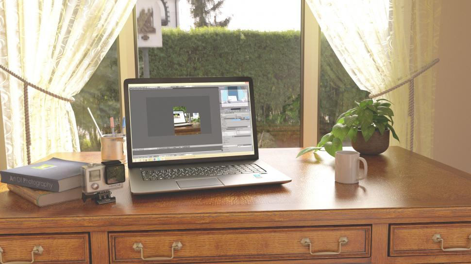 Download Free Stock Photo of Laptop near window