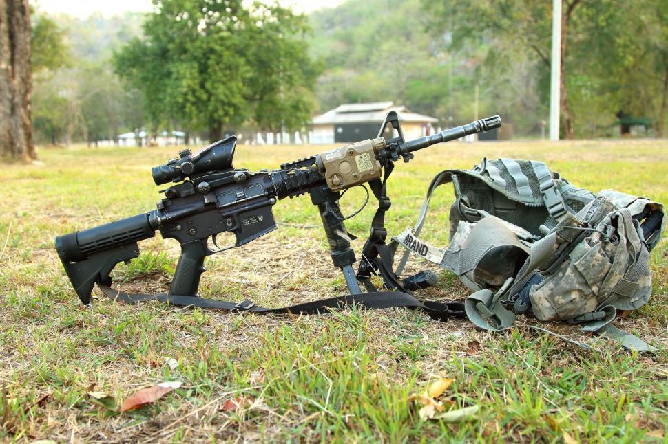 Download Free Stock Photo of Machine Gun and bulletproof jacket