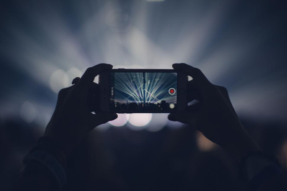 Download Free Stock HD Photo of Man with smartphone takes mobile photo at Music Concert  Online