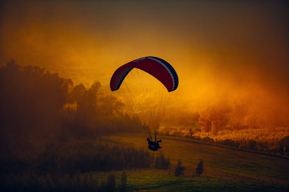 Download Free Stock Photo of Paragliding During Sunset