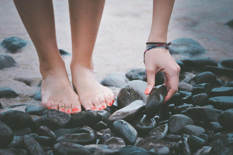 Download Free Stock Photo of Female Feet on pebble stones