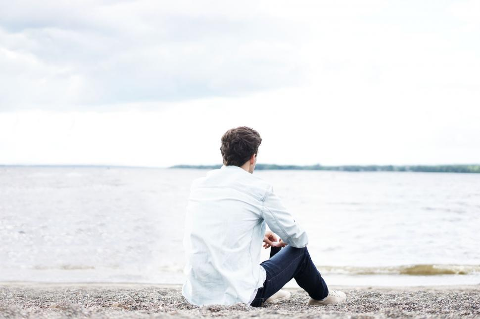 Download Free Stock Photo of Back side View of Alone Man on Beach