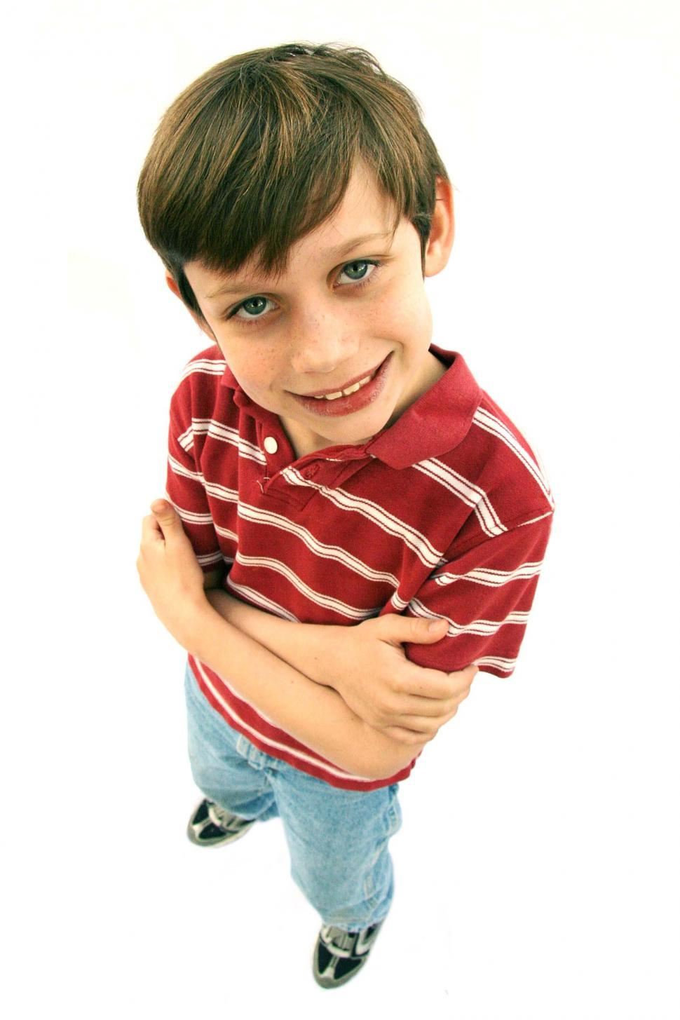 Download Free Stock Photo of Boy looking pleased with arms crossed