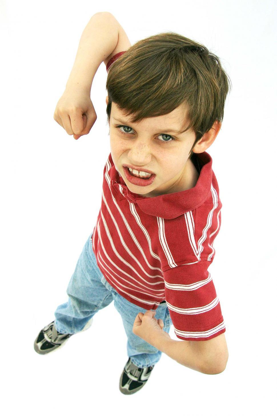 Download Free Stock Photo of Mad fighting boy