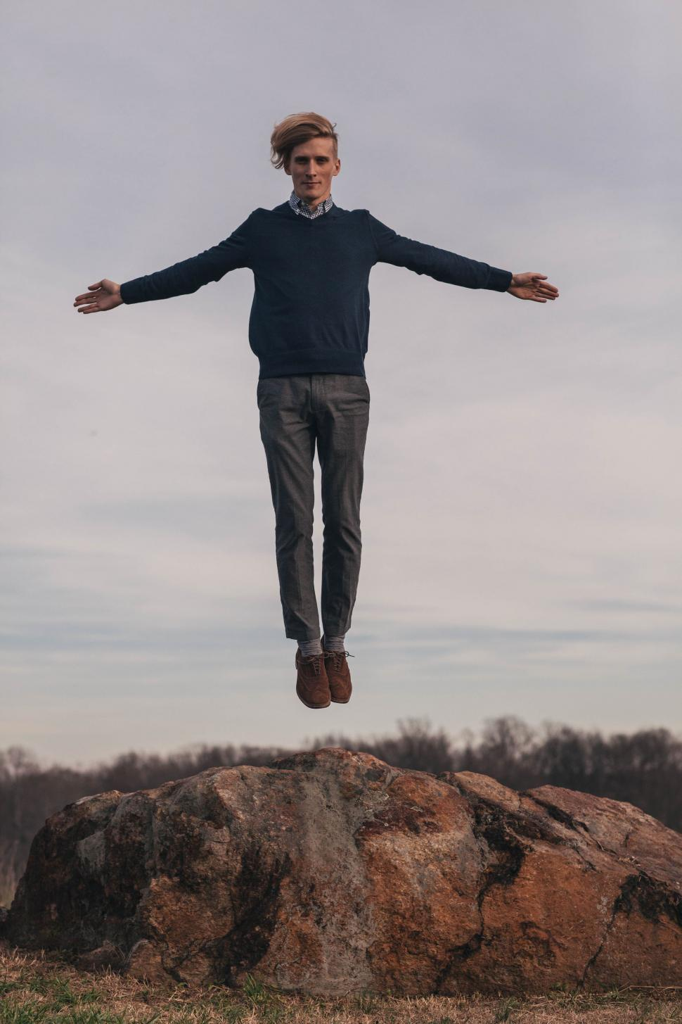 Download Free Stock Photo of Young Man Flying in the air