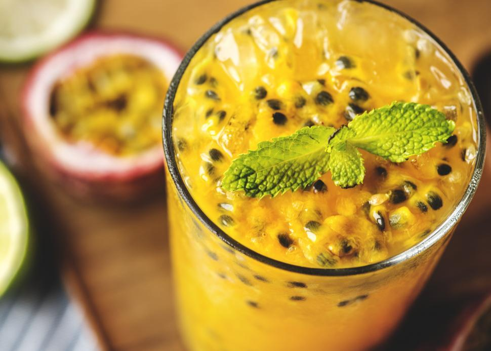Download Free Stock Photo of Close up of a glass of passion fruit smoothie