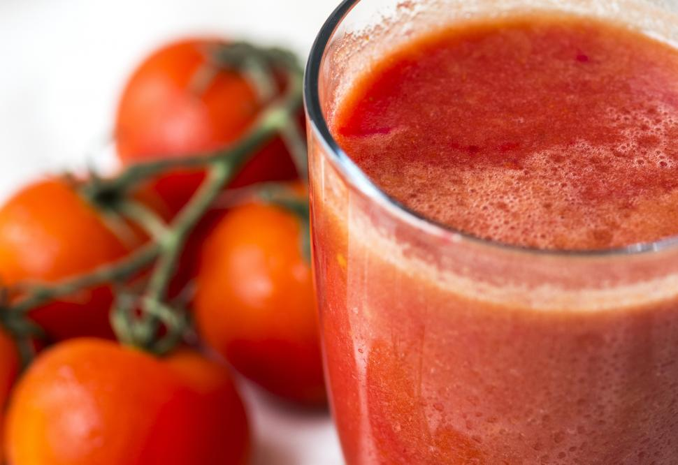 Download Free Stock HD Photo of Close up of a glass of tomato juice Online
