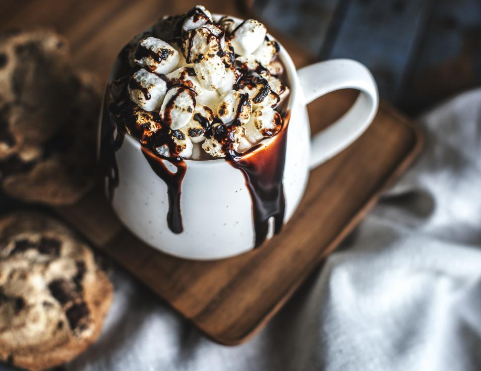 Download Free Stock Photo of Hot chocolate overflowing with marshmallows and chocolate sauce