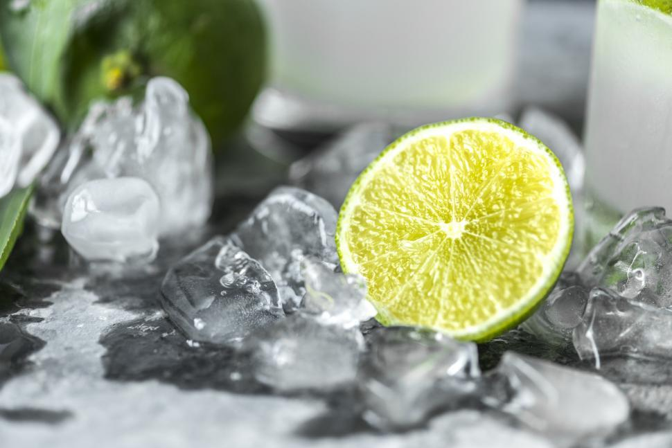 Download Free Stock HD Photo of Close up a sliced lime on ice Online