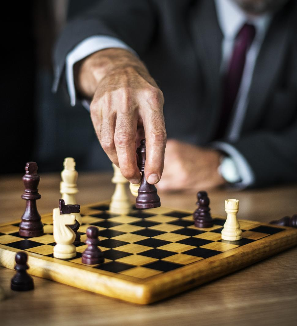 Download Free Stock Photo of Close up of a person playing chess